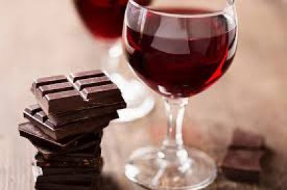 A Glass of Dry Red Wine With Dark Chocolate