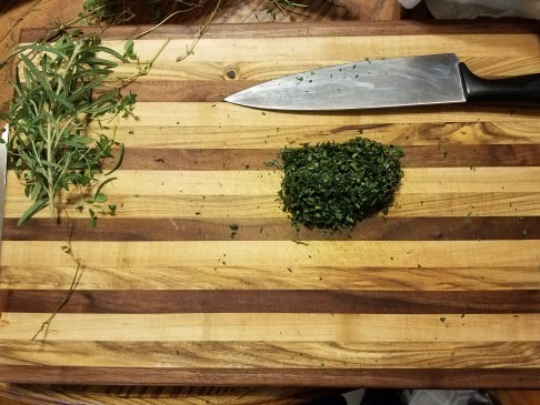 Welcome to Distinctive Choices  Home raised Basil, Marjoram and Thyme on a butcher block cutting board. An Intentional  Choice to eat better