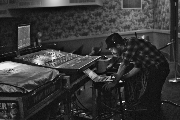 Daren Taylor works the sound board before the show.