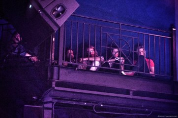 From the green room balcony, EL VY watches Flock of Dimes' opening set.