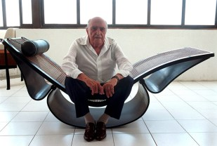 Niemeyer site on a lounge chair that he designed