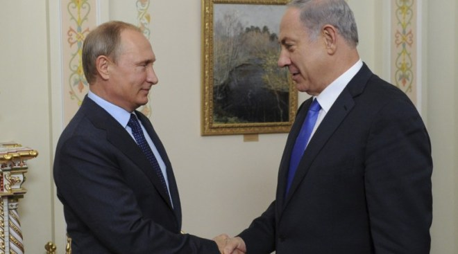 Putin and Netanyahu shake hands during their meeting at Novo-Ogaryovo state residence outside Moscow