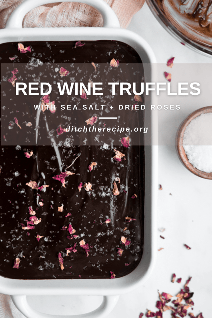 Pinterest graphic of red wine chocolate truffle mixture topped with flaky seal salt and dried rose petals.