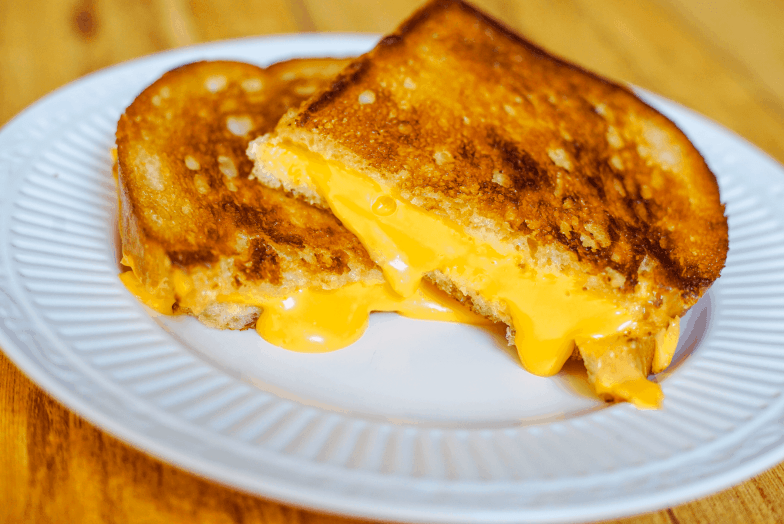 Toasty grilled cheese sandwich made with melty American cheese.