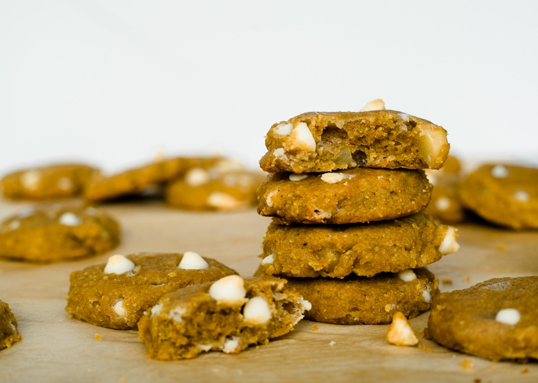 Stack of gluten-free pumpkin cookies surrounded by more cookies.