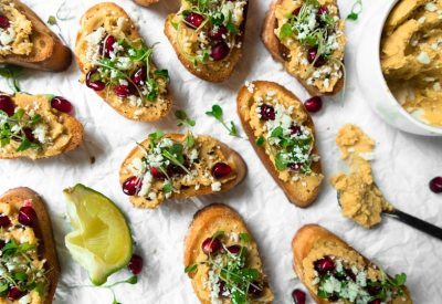 Crostini with butternut squash hummus, pomegranate arils, micro greens, and cotija cheese.