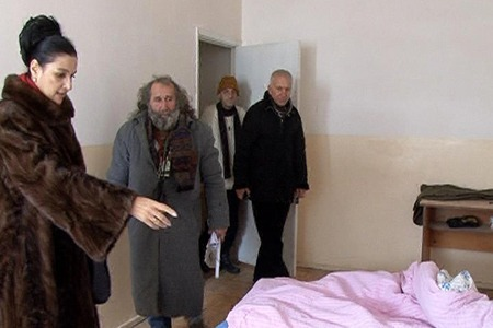 Armenia -- Municipal authorities show a homeless person his temporary shelter, Yerevan, 23Dec2011