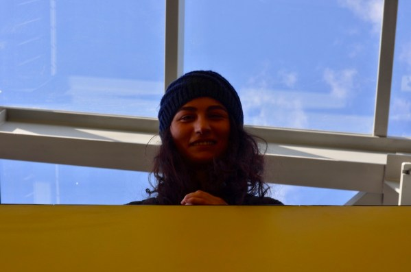 Armenia -- Tereza China Tokmajyan, a SMM specialist and Barcamp Yerevan volunteer, peers down the stairs of VTC, Barcamp Vanadzor, 06Nov2016