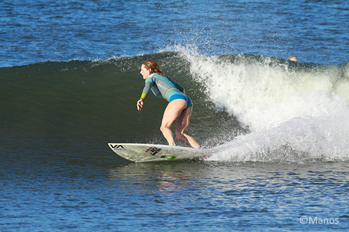 woman surfing in the ocean with The DivaCup