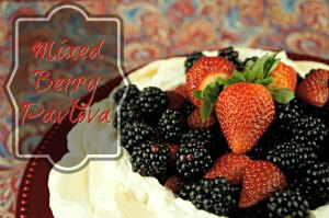 """How to make Pavlova, a """"secret weapon"""" dessert made of melt-in-your-mouth meringue with whipped cream topped with ripe berries. No one will know it's totally cheap!"""