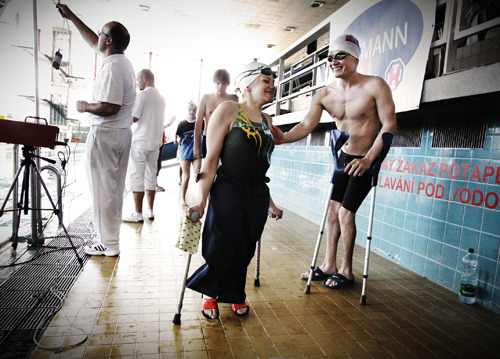Disabled_jan_beracka_wishes_his_friend_good_luck_in_the_upcoming_swimming_competition_2010_c_jan_caga_