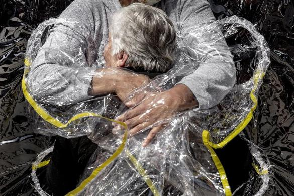 World Press Photo of the Year. The First Embrace. Mads Nissen