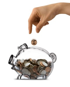 saving-money-in-a-clear-piggy-bank