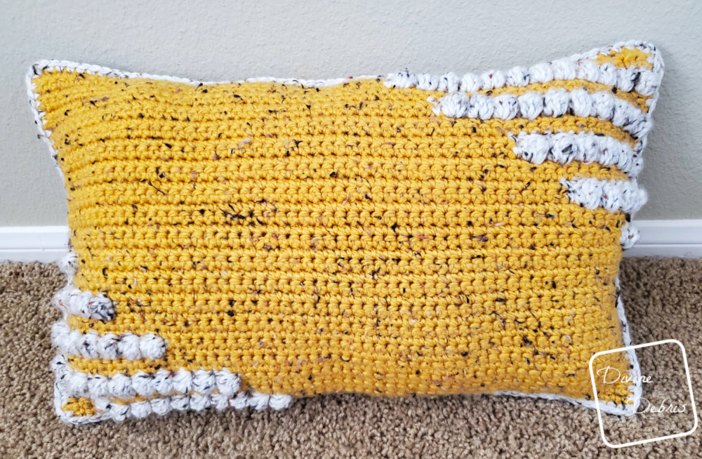 Learn to make the fun and squishy bulky weight yarn pillow, the Charismatic Pillow, from a free crochet pattern by DivineDebris.com