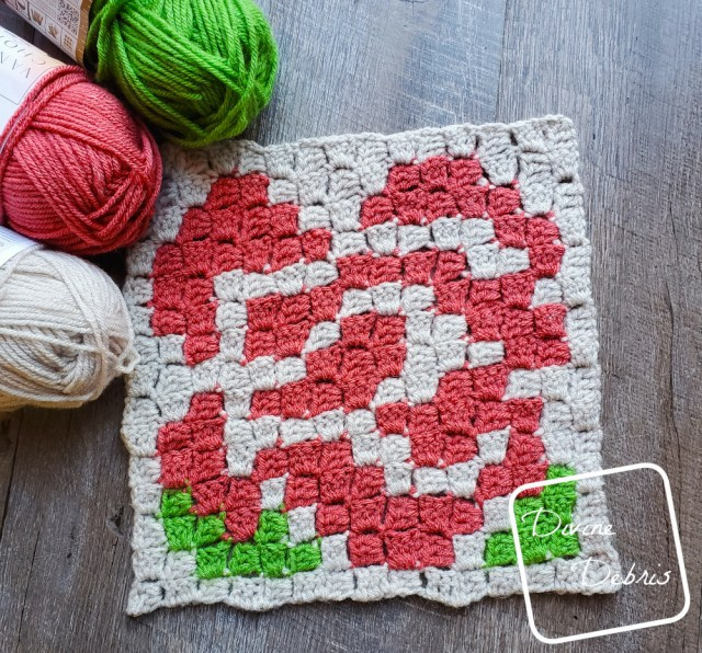 [image description] Rose Afghan Square crochet pattern with 3 skeins of yarn in the top left corner.