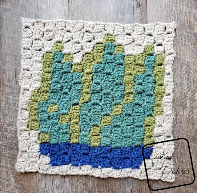 [Image description] the C2C Agave Square lays half-finished flat on a wood grain background