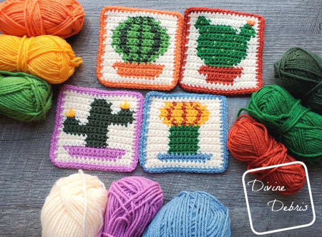 The four cactus coasters lay in the center of the photo, with stacks of 3 skeins of yarn around the sides and bottom of the photo .
