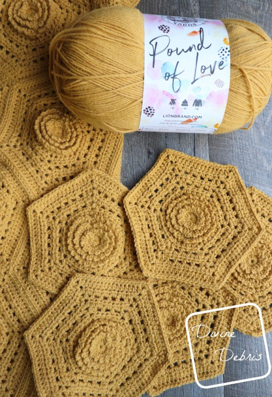 [Image description] Top down view of a skein of Lion Brand yarns Pound of love in Maize and the Florence Hexagon Blanket hexagons made in the yarn on a wood grain background.