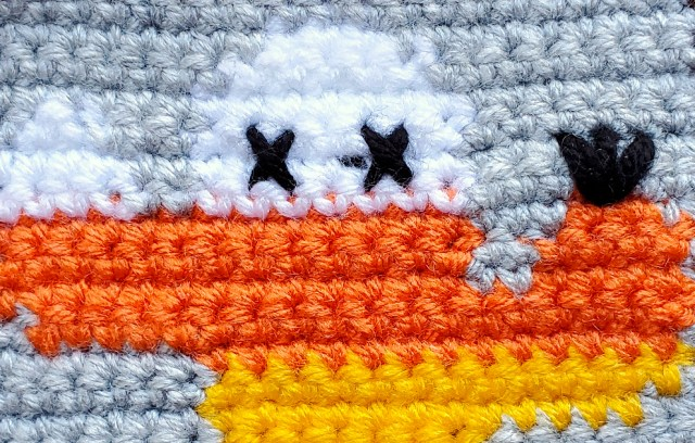 [Image description] Close up of the Candy Corn Cactus's details, such as the X's for eyes and black flower.