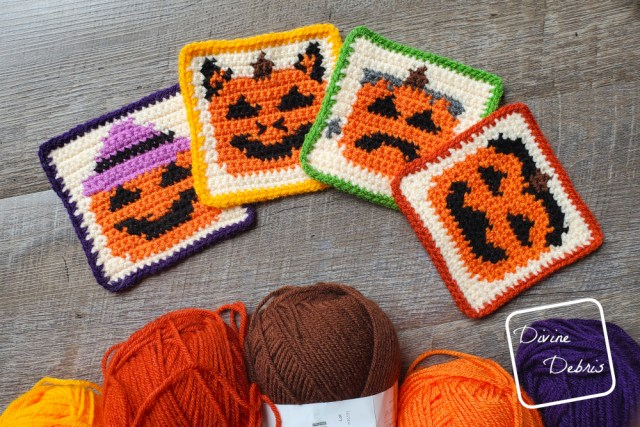 [Image description] The four Halloween Pumpkin Coasters crochet patterns lay flat on a wood-grain background with 5 skeins of yarn along the bottom of the photo.