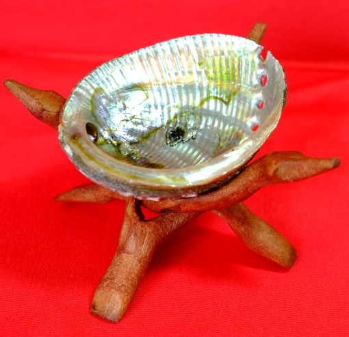 Shiny abalone shell with wooden tripod stand