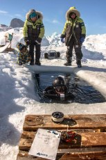 The dive team readies for a deep dive in Uummannaq Bay during Under the Pole II. Photo © Franck Gazzola | Under the Pole II
