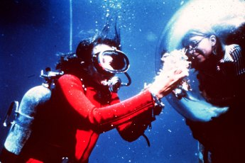 Dr. Sylvia Earle displays samples to aquanaut during Tektite II in 1970. Photo by NOAA