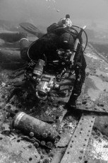 Chris Harvey-Clark documenting unexploded ordnance from the wreck of HMS Raleigh (Labrador). Photo © Jeffrey Gallant | Diving Almanac