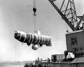 Bathyscaphe Trieste is hoisted out of the water, circa 1958-59. Photo by U.S. Navy (Public Domain)