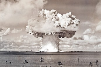 Baker atomic bomb blast at Bikini Atoll. Photo by Museum of Photographic Arts Collections (Public Domain)