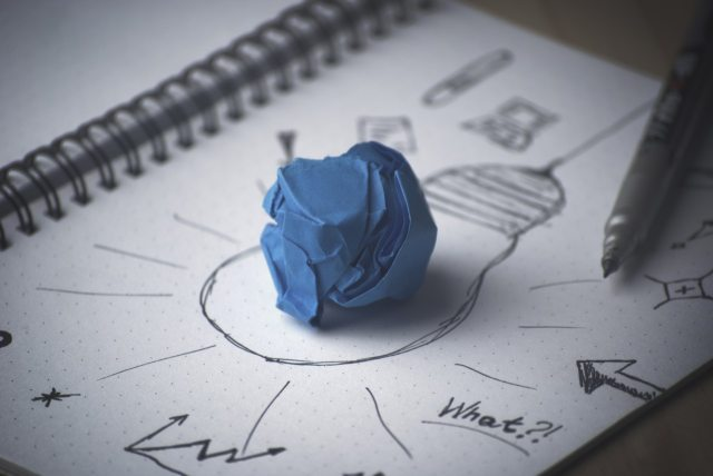 Doodle of a lightbulb with a ball of blue clay on top