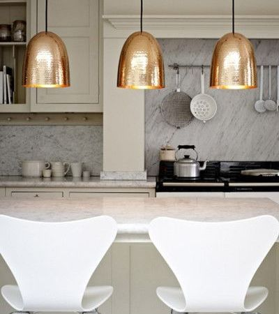 Copper pendant light above kitchen bench