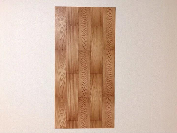 ダイソーの筒状のリメイクシート 組木風木目柄を壁に貼ってみた