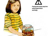 Girl with ant farm in a jar