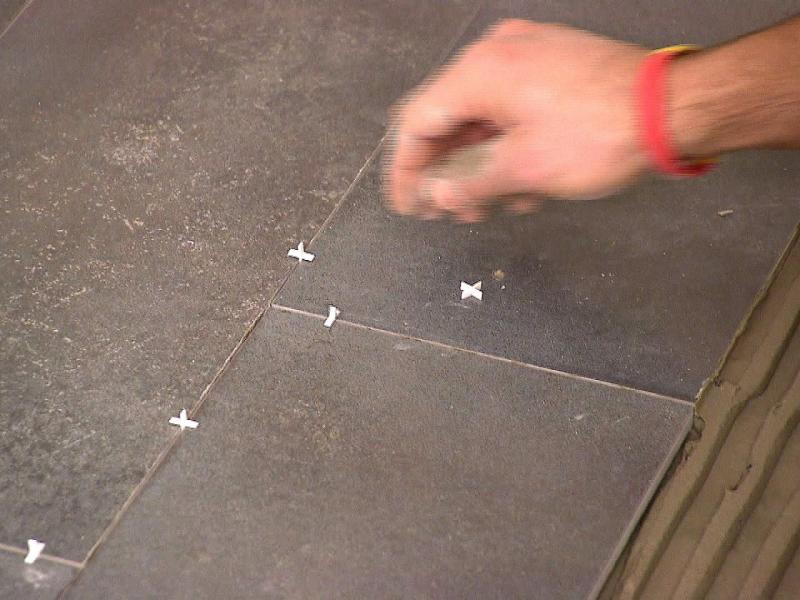 How to Install a Plank Tile Floor   how tos   DIY Step 5  dkim109 plank tile floor grout spacers s4x3