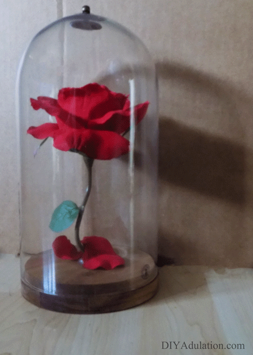 A DIY Beauty and the Beast enchanted rose cloche is the perfect way to add some covert nerd décor to your home.