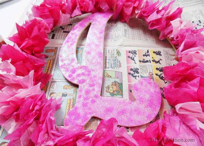 If your Valentine's style this year is loving all things pink and sparkly then this DIY monogram Valentine wreath is perfect.