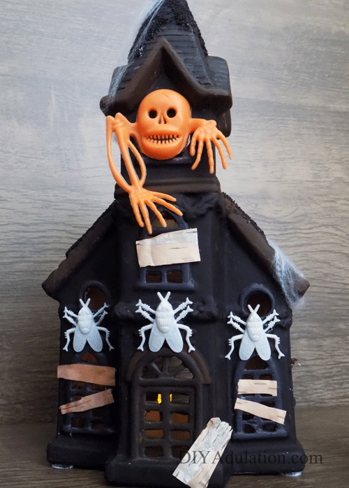 This DIY haunted house makeover will have you running to the thrift store to find your own Christmas statue! Find out how to make it now!