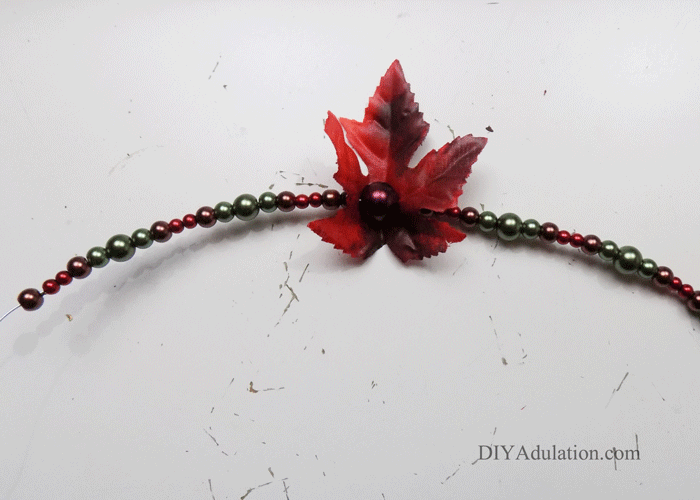 Dress up your holiday place settings without fancy china. These DIY beaded autumn leaves napkin rings instantly add an elegant and festive touch.