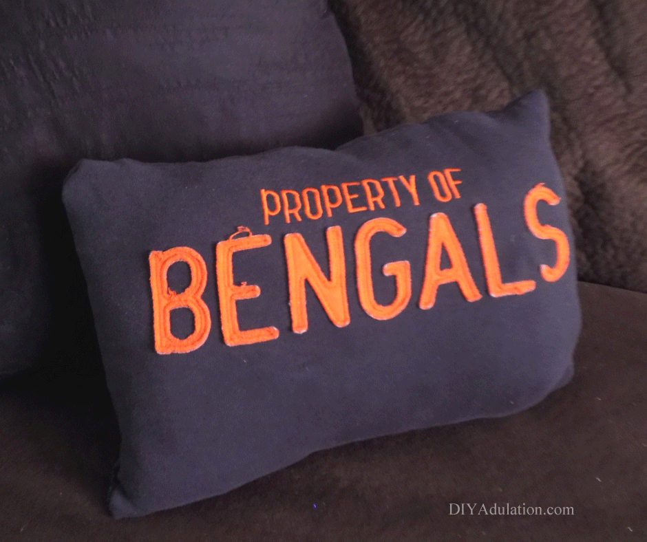 Super Bowl still brings out the creative football spirit even when your team isn't in the game. This DIY upcycled Bengals throw pillow is easy to make and easy to customize to your favorite team.