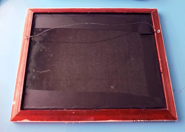 Back of Chalkboard Insert inside of frame
