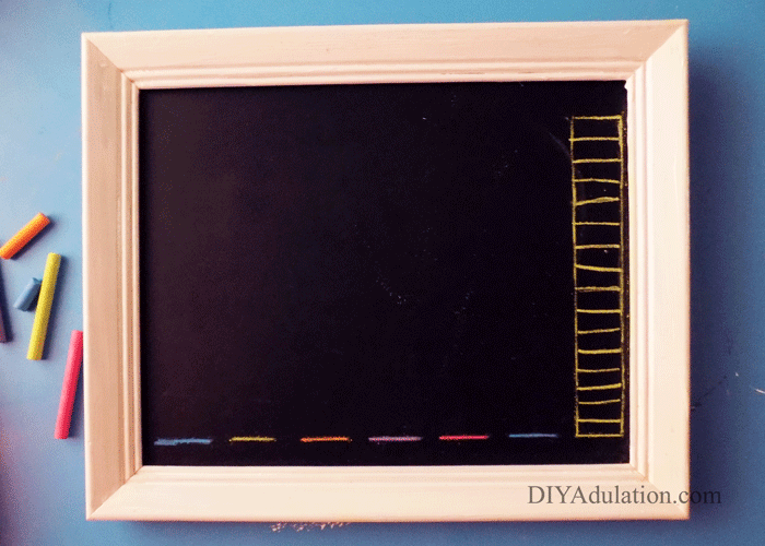 Chalkboard with colorful horizontal lines and a bar graph on the right