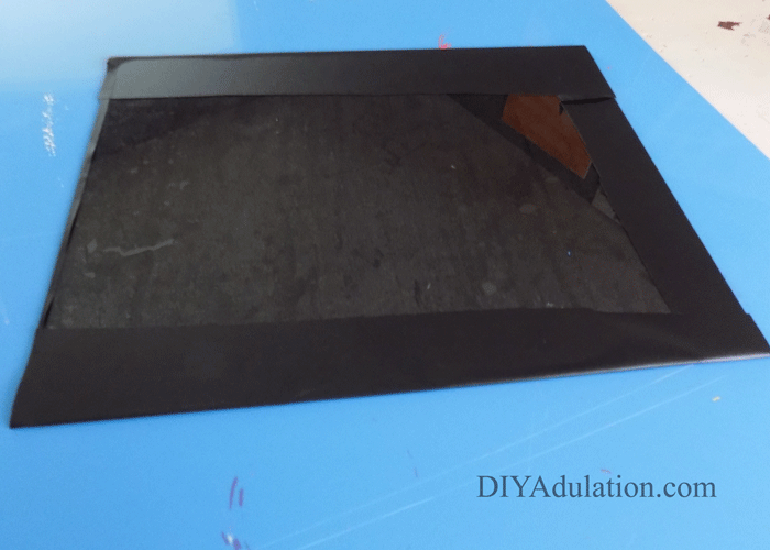 Folded Edge of Chalkboard Contact Paper on the Back of the Glass Insert