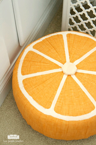 Orange fruit slice pouf on the floor