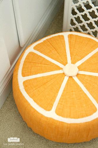 Orange fruit slice pouf on the floor