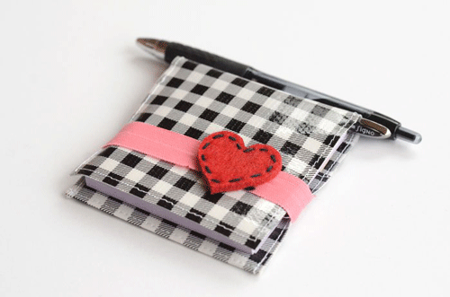 Plaid Post-It Note holder with pink ribbon and a red heart