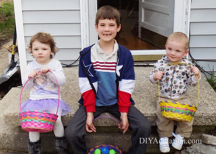 3 Kids sitting on a stoop with Easter Baskets