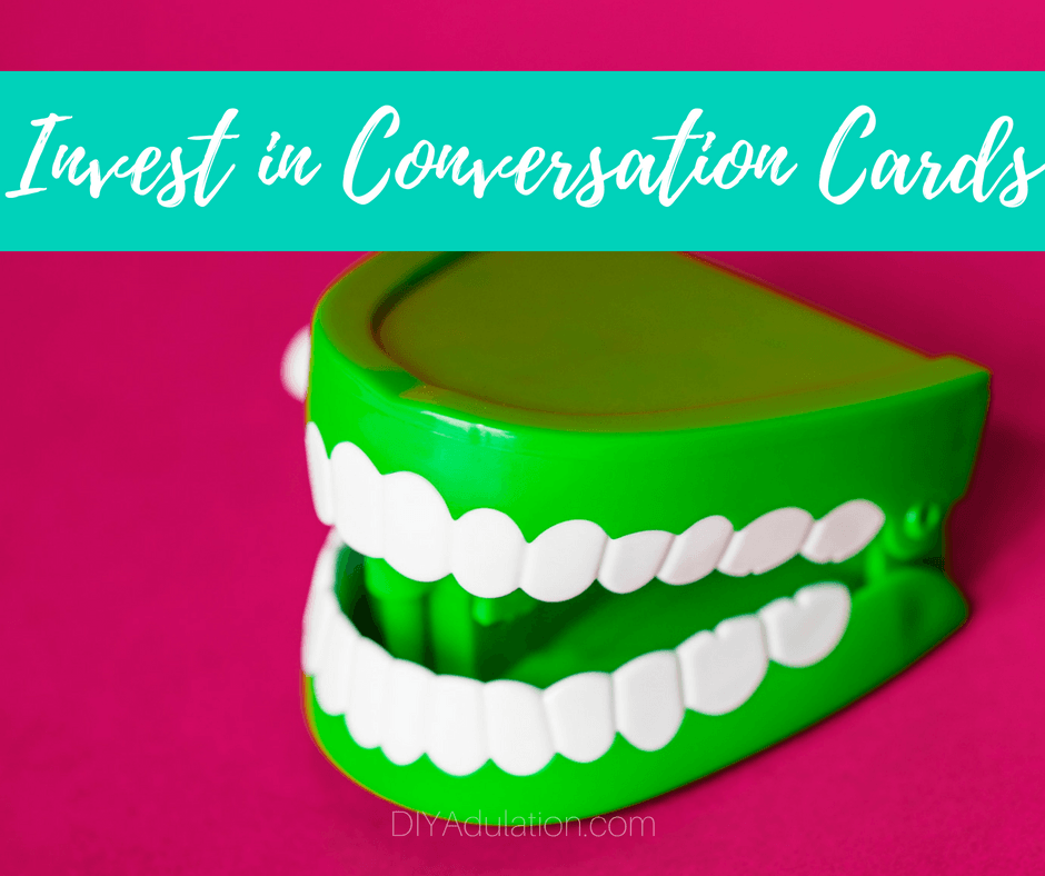Green Chattering Teeth toy with text overlay: Invest in Conversation Cards