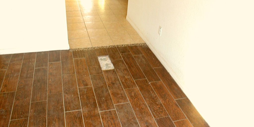 how to fix a loose floor tile diy all day