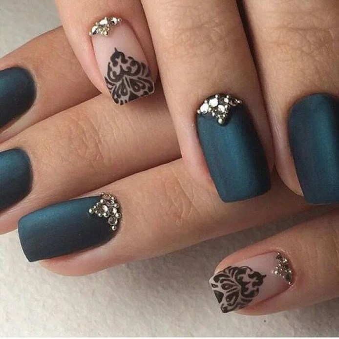 This navy blue and black lace nail design is really cute! It's very clean too!